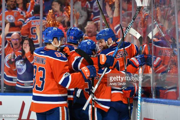 Zack Kassian David Desharnais Matthew Benning and Patrick Maroon of the Edmonton Oilers celebrate after goal in Game Five of the Western Conference...