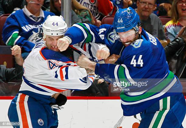 Zack Kassian of the Edmonton Oilers and Erik Gudbranson of the Vancouver Canucks trade punches during their NHL game at Rogers Arena October 28 2016...