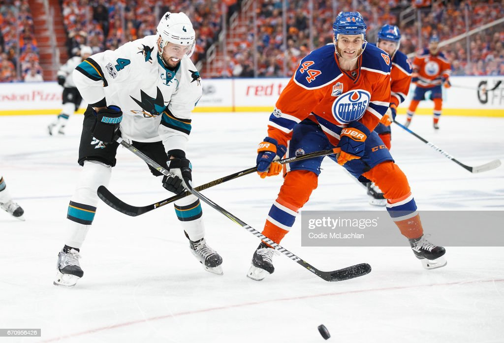 Zack Kassian #44 of the Edmonton Oilers battles against Brenden Dillon #4 of the San Jose Sharks in Game Five of the Western Conference First Round during the 2017 NHL Stanley Cup Playoffs at Rogers Place on April 20, 2017 in Edmonton, Alberta, Canada.