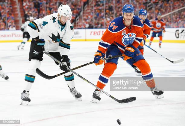 Zack Kassian of the Edmonton Oilers battles against Brenden Dillon of the San Jose Sharks in Game Five of the Western Conference First Round during...