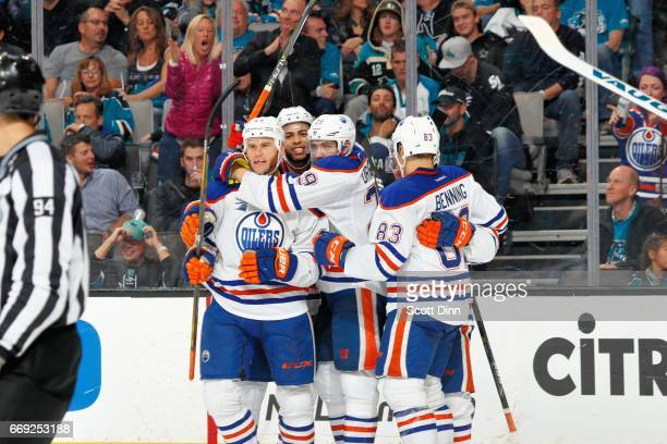Zack Kassian of the Edmonton Oilers celebrates his third period goal with teammates in Game Three of the Western Conference First Round during the...
