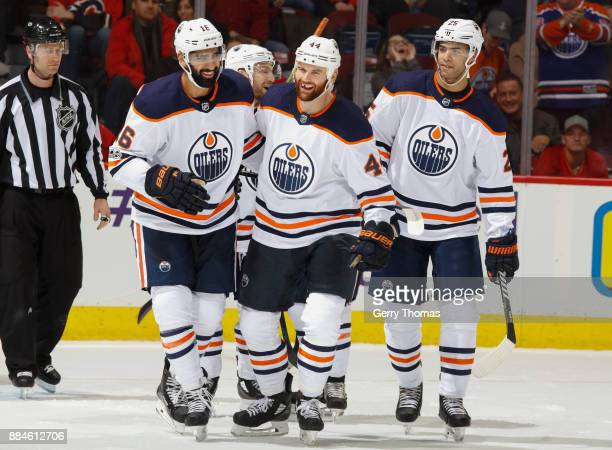 Zack Kassian of the Edmonton Oilers celebrates with teammates after a goal against the Calgary Flames at Scotiabank Saddledome on December 2 2017 in...