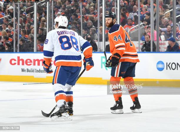 Zack Kassian of the Edmonton Oilers exchanges words with Brandon Davidson of the New York Islanders on March 8 2018 at Rogers Place in Edmonton...