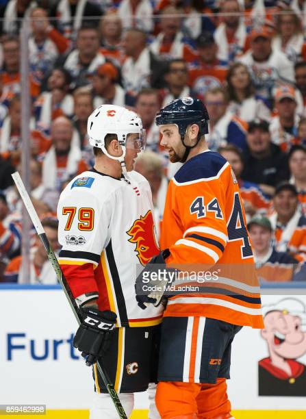 Zack Kassian of the Edmonton Oilers exchanges words with Micheal Ferland of the Calgary Flames at Rogers Place on October 4 2017 in Edmonton Canada