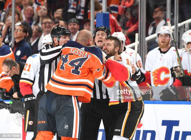 Zack Kassian of the Edmonton Oilers fights with Tanner Glass of the Calgary Flames on October 4 2017 at Rogers Place in Edmonton Alberta Canada