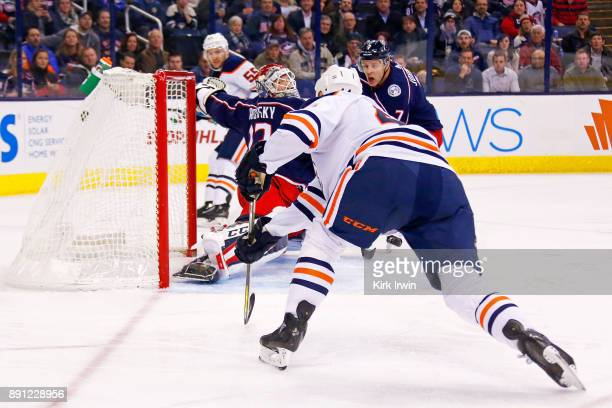Zack Kassian of the Edmonton Oilers fires a shot past Sergei Bobrovsky of the Columbus Blue Jackets for a goal during the first period on December 12...