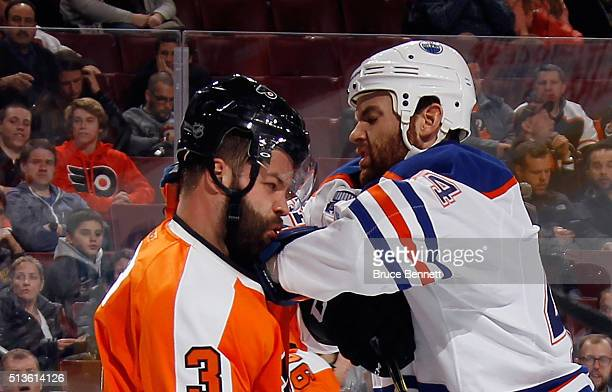 Zack Kassian of the Edmonton Oilers gets the elbow up on Radko Gudas of the Philadelphia Flyers during the third period at the Wells Fargo Center on...
