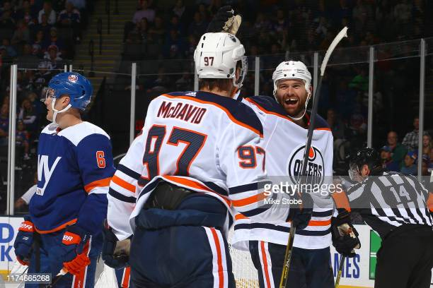 Zack Kassian of the Edmonton Oilers is congratulated by his teammate Connor McDavid after scoring a goal against the New York Islanders during the...