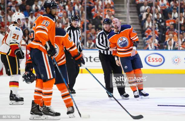 Zack Kassian of the Edmonton Oilers is covered in blood after a fight with Tanner Glass of the Calgary Flames in the season opener at Rogers Place on...