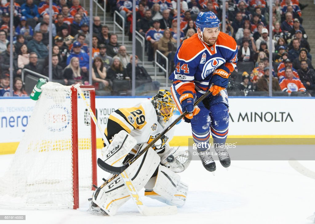 Zack Kassian #44 of the Edmonton Oilers jumps in front of goalie Marc-Andre Fleury #29 of the Pittsburgh Penguins on March 10, 2017 at Rogers Place in Edmonton, Alberta, Canada.
