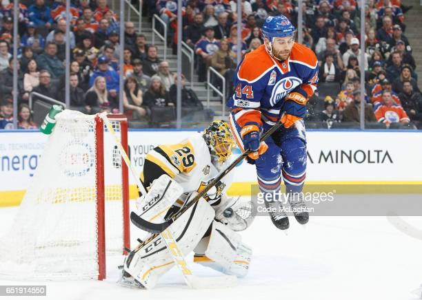 Zack Kassian of the Edmonton Oilers jumps in front of goalie Marc-Andre Fleury of the Pittsburgh Penguins on March 10, 2017 at Rogers Place in...