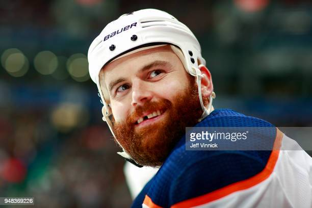 Zack Kassian of the Edmonton Oilers looks on from the bench during their NHL game against the Vancouver Canucks at Rogers Arena March 29 2018 in...