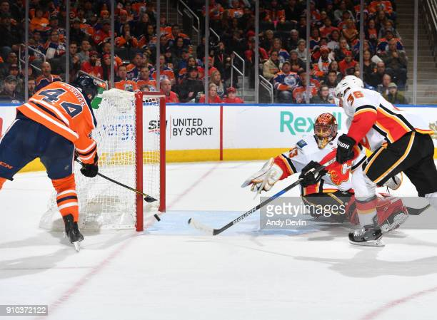 Zack Kassian of the Edmonton Oilers scores a goal on David Rittich of the Calgary Flames on January 25 2017 at Rogers Place in Edmonton Alberta Canada