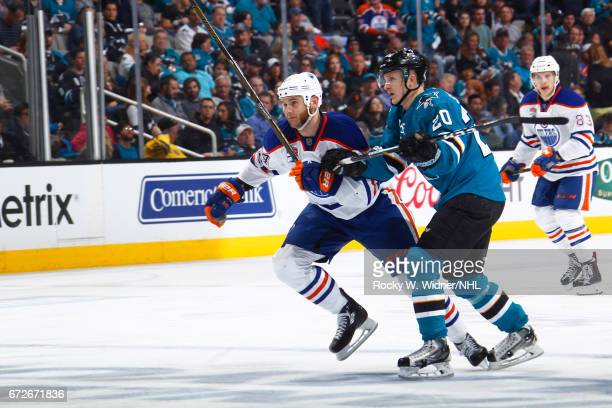 Zack Kassian of the Edmonton Oilers skates against Marcus Sorensen of the San Jose Sharks in Game Six of the Western Conference First Round during...