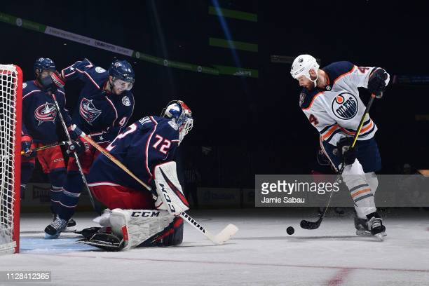 Zack Kassian of the Edmonton Oilers skates with the puck as goaltender Sergei Bobrovsky of the Columbus Blue Jackets defends the net during the...