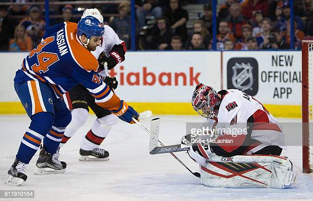 Zack Kassian of the Edmonton Oilers takes a shot on goaltender Craig Anderson of the Ottawa Senators on February 23 2016 at Rexall Place in Edmonton...