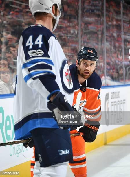 Zack Kassian of the Edmonton Oilers talks to Josh Morrissey of the Winnipeg Jets on October 9 2017 at Rogers Place in Edmonton Alberta Canada