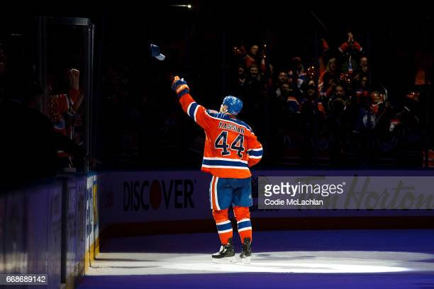 Zack Kassian of the Edmonton Oilers throws a hat into the crowd after being named the first star of the game against the San Jose Sharks in Game Two...