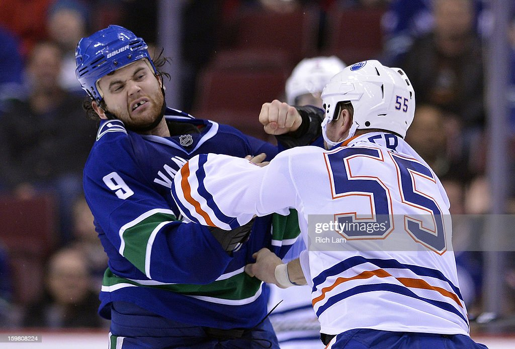 Zack Kassian #9 of the Vancouver Canucks and Ben Eager #55 of the Edmonton Oilers fight during the third period of NHL action on January 20, 2013 at Rogers Arena in Vancouver, British Columbia, Canada.