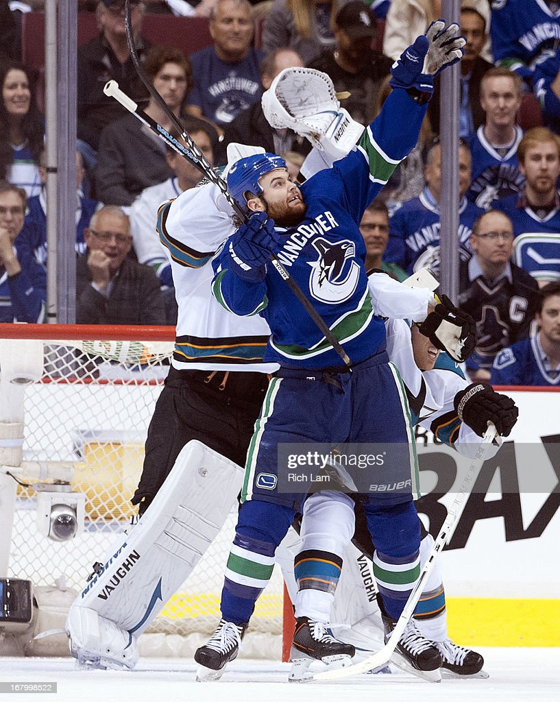 Zack Kassian #9 of the Vancouver Canucks and goalie Antti Niemi #31 of the San Jose Sharks reach for the puck during the first period of Game Two of the Western Conference Quarterfinals of the 2013 NHL Stanley Cup Playoffs, May 03, 2013 at Rogers Arena in Vancouver, British Columbia, Canada.