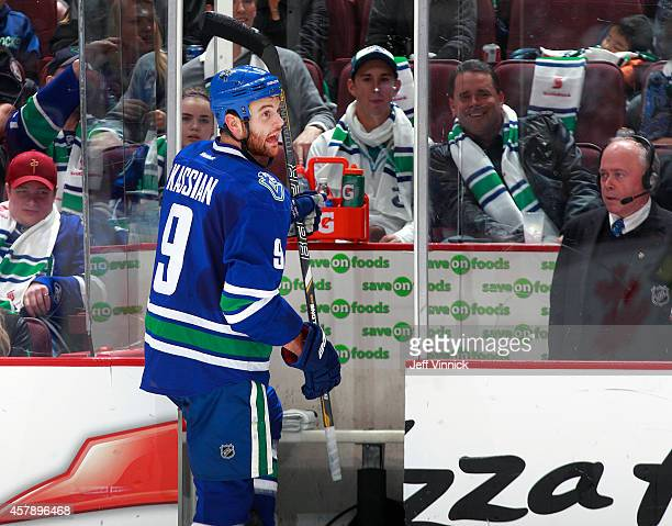 Zack Kassian of the Vancouver Canucks argues with a referee as he steps into the penalty box during their NHL game against theTampa Bay Lightning at...
