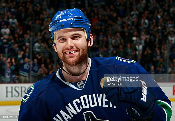 Zack Kassian of the Vancouver Canucks celebrates after scoring the shootoutwinning goal against the Calgary Flames during their NHL game at Rogers...