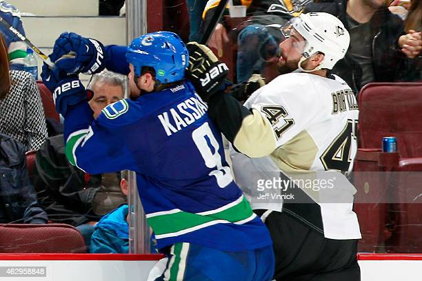 Zack Kassian of the Vancouver Canucks collides with Robert Bortuzzo of the Pittsburgh Penguins during their NHL game at Rogers Arena February 7, 2015...