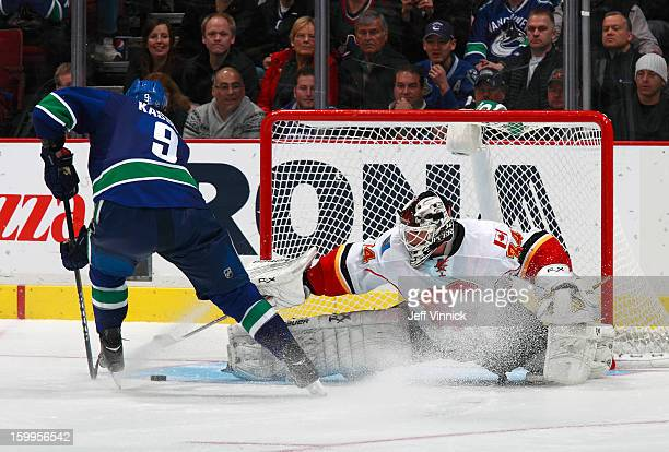 Zack Kassian of the Vancouver Canucks goes to his backhand to beat Miikka Kiprusoff of the Calgary Flames for the shootout-winning goal during their...