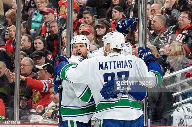 Zack Kassian of the Vancouver Canucks reacts after scoring against the Chicago Blackhawks in the second period during the NHL game at the United...