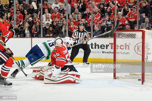 Zack Kassian of the Vancouver Canucks scores on goalie Corey Crawford of the Chicago Blackhawks in the second period during the NHL game at the...