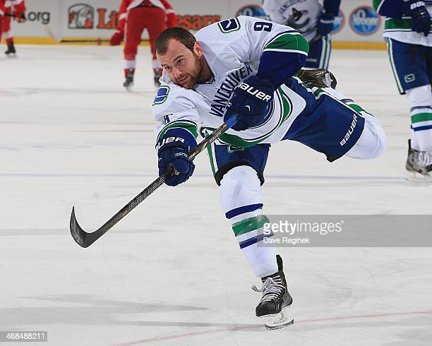 Zack Kassian of the Vancouver Canucks shoots the puck in warmups prior to the NHL game against the Detroit Red Wings on February 3 2014 at Joe Louis...
