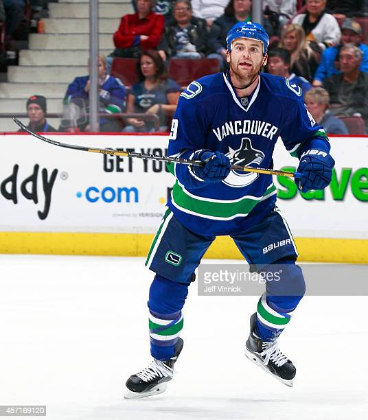 Zack Kassian of the Vancouver Canucks skates up ice during their NHL game against the Edmonton Oilers at Rogers Arena October 11 2014 in Vancouver...
