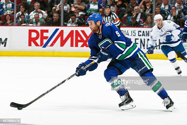 Zack Kassian of the Vancouver Canucks skates up ice with the puck during their NHL game against theTampa Bay Lightning at Rogers Arena October 18...