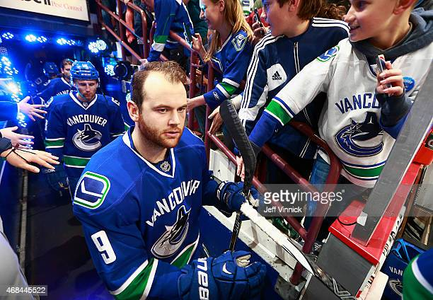 Zack Kassian of the Vancouver Canucks walks out to the ice during their NHL game against the Toronto Maple Leafs at Rogers Arena March 14 2015 in...