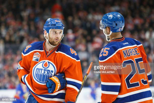 Zack Kassian strategizes with Darnell Nurse of the Edmonton Oilers against the Detroit Red Wings on March 4 2017 at Rogers Place in Edmonton Alberta...