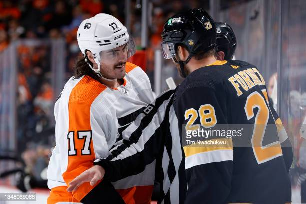 Zack MacEwen of the Philadelphia Flyers is spearated from Derek Forbort of the Boston Bruins at Wells Fargo Center on October 20, 2021 in...