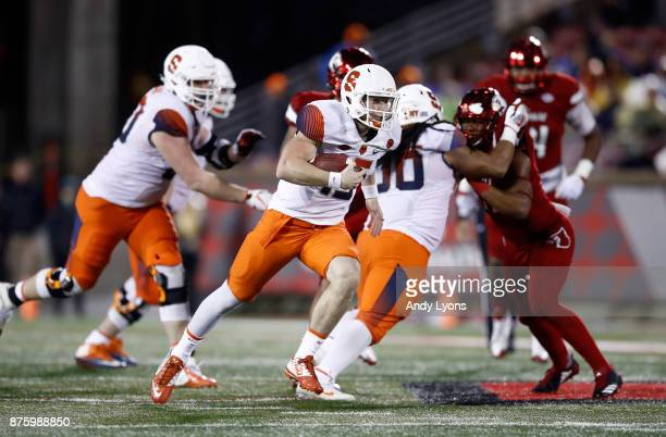 Zack Mahoney of the Syracuse Orange runs with the ball against the Louisville Cardinals during the game at Papa John's Cardinal Stadium on November...