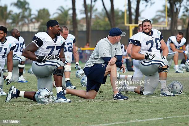 Zack Martin of the Dallas Cowboys talks with a coach after training camp on August 2 2016 in Oxnard California