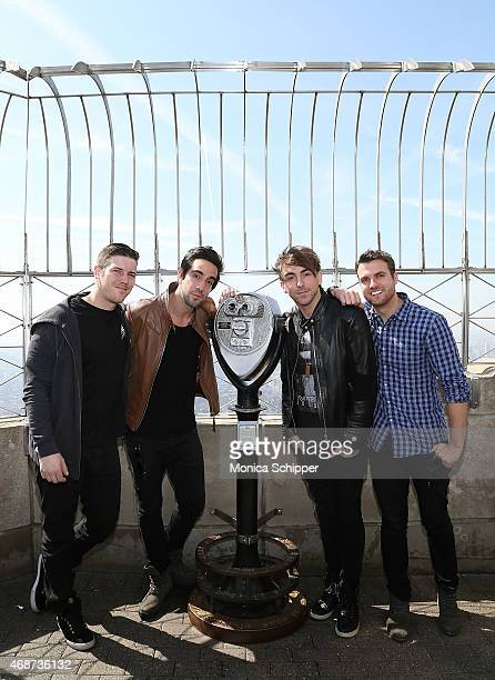 Zack Merrick Jack Barakat Alex Gaskarth and Rian Dawson all of band All Time Low visit The Empire State Building on April 6 2015 in New York City