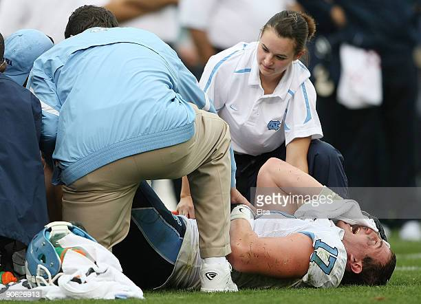 Zack Pianalto of the North Carolinia Tar Heels grimaces as he is attended to by the medical staff on September 12 2009 at Rentschler Field in East...