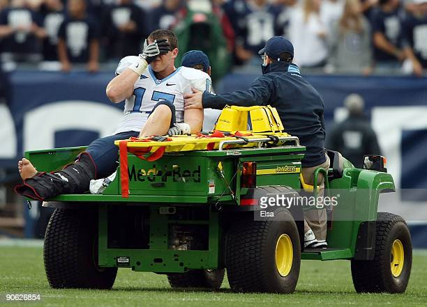 Zack Pianalto of the North Carolinia Tar Heels is carted off the field after he was injured scoring a touchdown to tie the game late in the fourth...