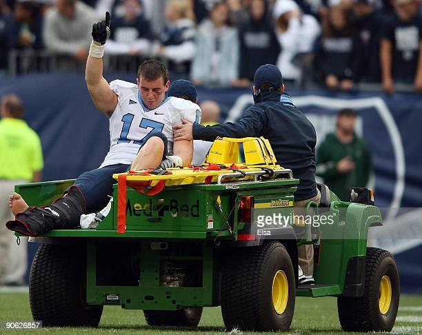 Zack Pianalto of the North Carolinia Tar Heels salutes the fans as he is carted off the field Pianalto was injured scoring a touchdown to tie the...
