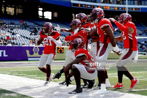 Zack Sanchez of the San Antonio Commanders is congratulated by his teammates after an interception against the Atlanta Legends during the first half...