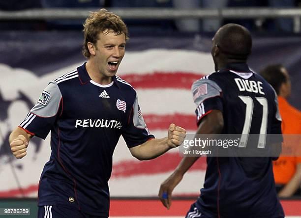 Zack Schilawski of the New England Revolution celebrates with teammate Kheli Dube after Schilawski scored a goal in the first half against FC Dallas...
