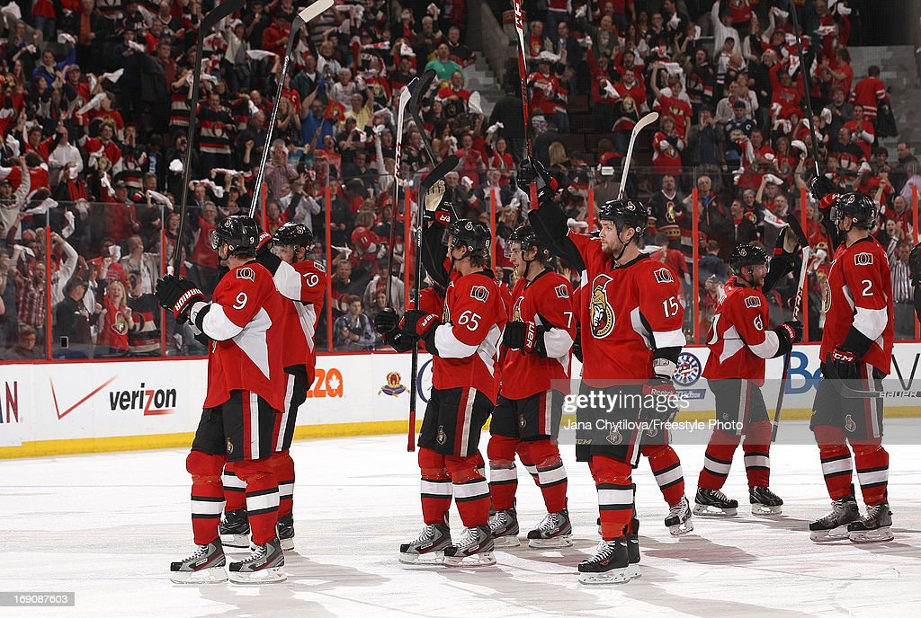 Zack Smith #15 and the rest of the Ottawa Senators celebrate their double overtime win against the Pittsburgh Penguins in Game Three of the Eastern Conference Semifinals during the 2013 NHL Stanley Cup Playoffs, at Scotiabank Place, on May 19, 2013 in Ottawa, Ontario, Canada.