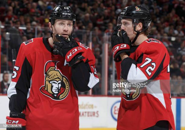 Zack Smith and Thomas Chabot of the Ottawa Senators talk before a faceoff in a game against the Los Angeles Kings at Canadian Tire Centre on October...