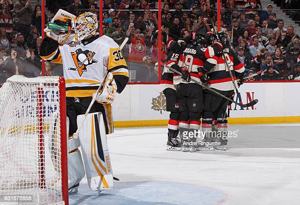 Zack Smith Bobby Ryan and Dion Phaneuf of the Ottawa Senators celebrate a third period goal against Matt Murray of the Pittsburgh Penguins at...