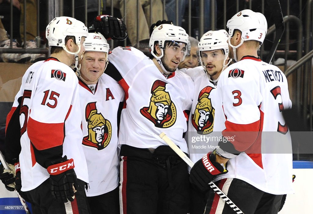 Zack Smith #15, Chris Neil #25, Mika Zibanejad #93, Erik Karlsson #65 and Marc Methot #3 of the Ottawa Senators celebrate after Zibanejad scored the second goal against the New York Rangers during the first period at Madison Square Garden on April 5, 2014 in New York City.