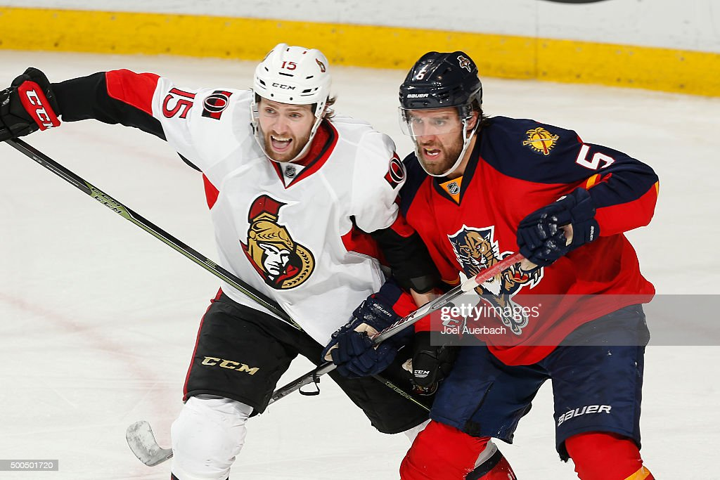 Zack Smith #15 of the Ottawa Senators and Aaron Ekblad #5 of the Florida Panthers battle for position during third period action at the BB&T Center on December 8, 2015 in Sunrise, Florida. The Senators defeated the anthers 4-2.