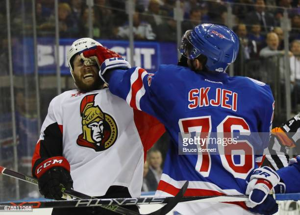 Zack Smith of the Ottawa Senators and Brady Skjei of the New York Rangers battle during the first period in Game Four of the Eastern Conference...